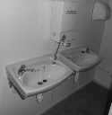 SINK UNITS INSIDE TOILETS INSIDE 32' x 10' ANTI VANDAL CABIN