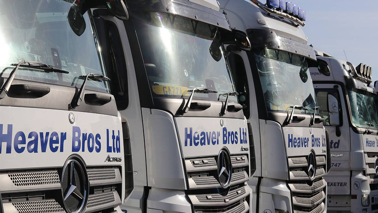 4 heaver brothers haulage trucks lined up side by side