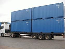 shipping containers on back of lorry